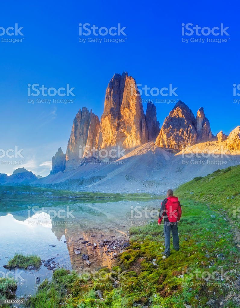 Hiker looking at  the three Pinnacles at sunrise stock photo