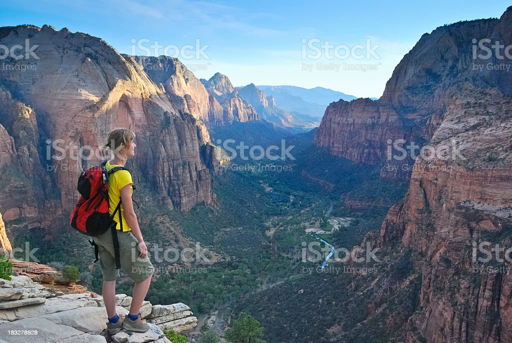 Hiker looking at views of mountains stock photo