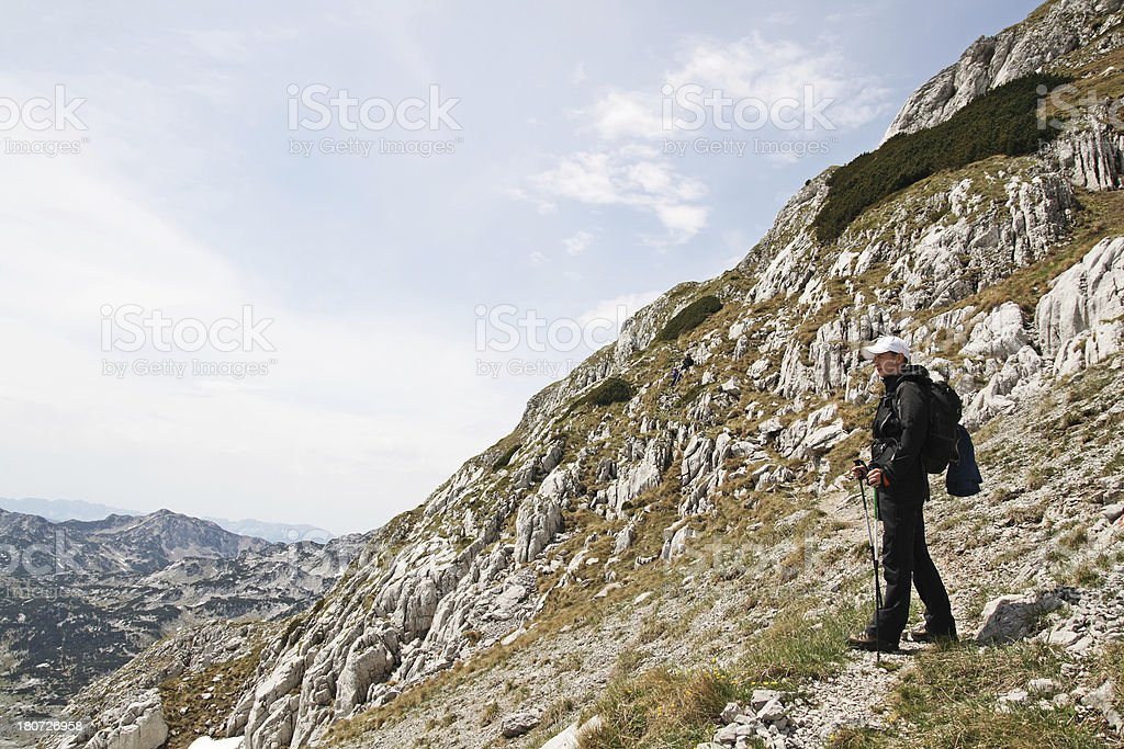 Hiker looking from the mountain royalty-free stock photo