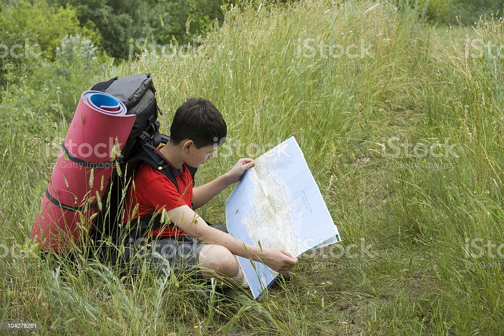Hiker looking in the map royalty-free stock photo