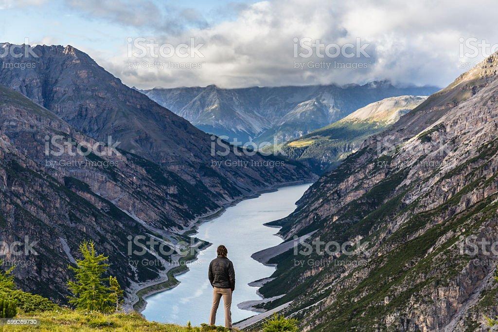Hiker man enjoy lake mountain view stock photo