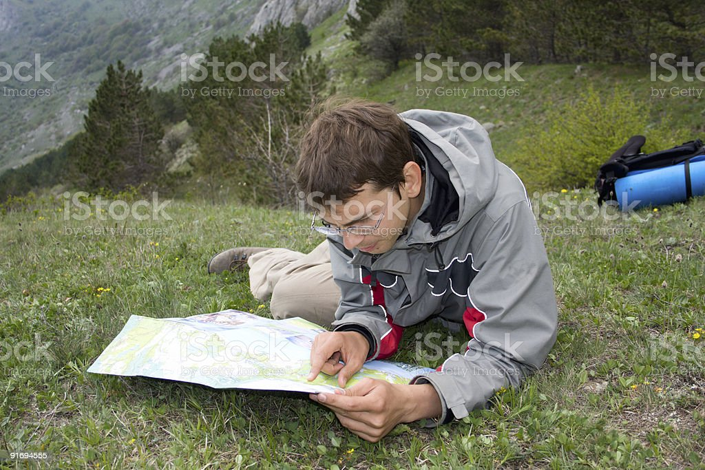 Hiker man looking to the map royalty-free stock photo