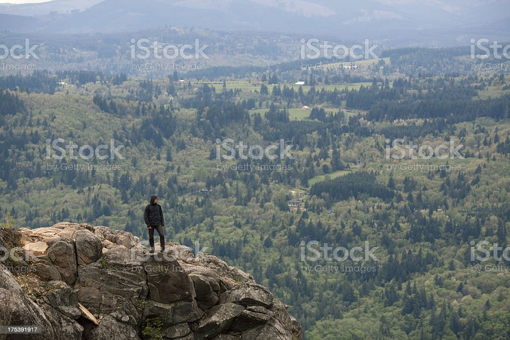 Hiker Man Standing on Cliff's Edge royalty-free stock photo