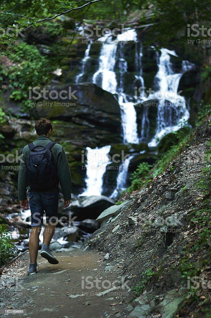 Hiker near waterfall royalty-free stock photo