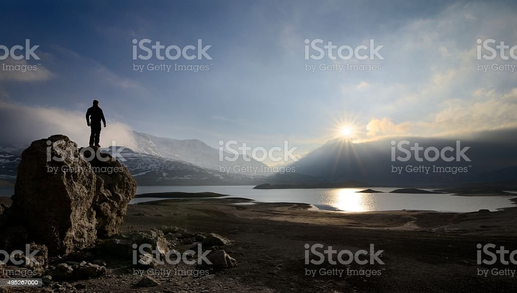 Hiker observes the Mont-Cenis lake stock photo