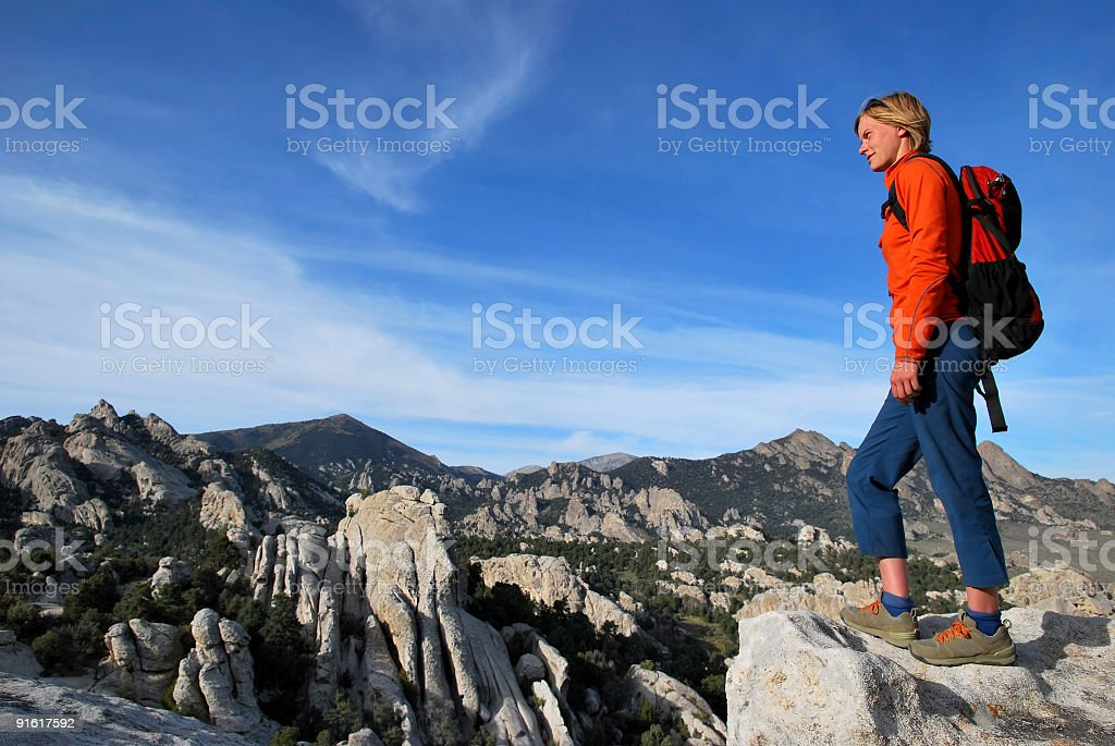 Hiker on a bluff royalty-free stock photo