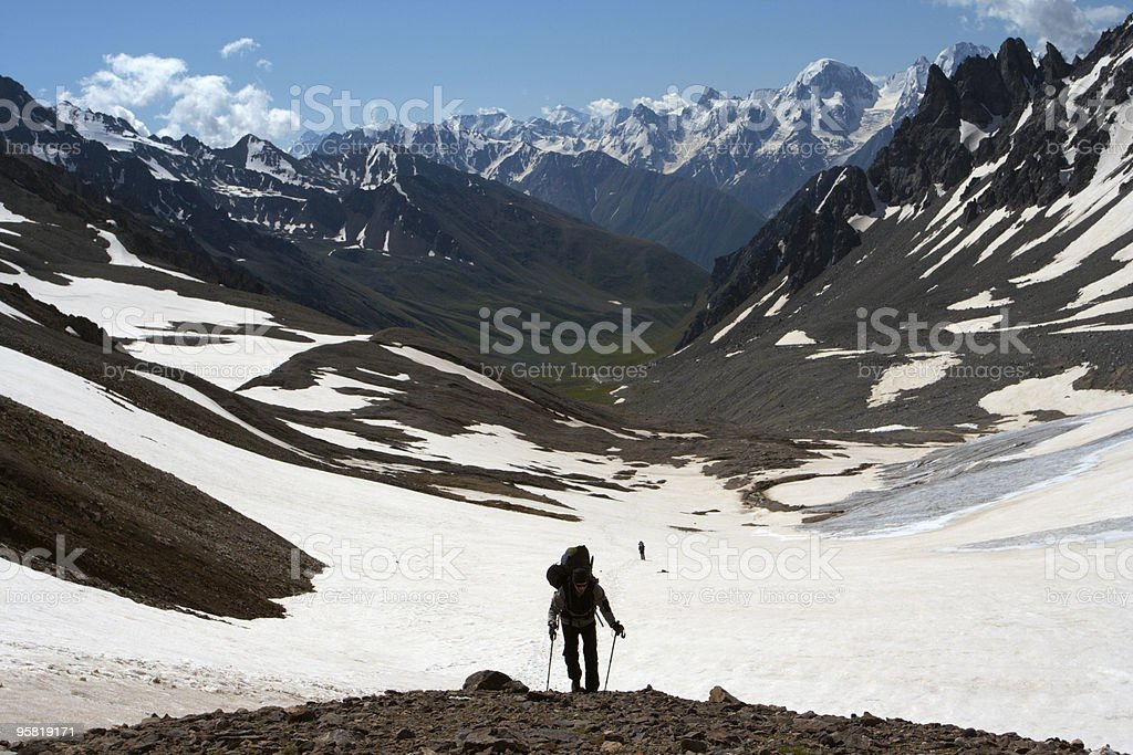hiker on a rise stock photo