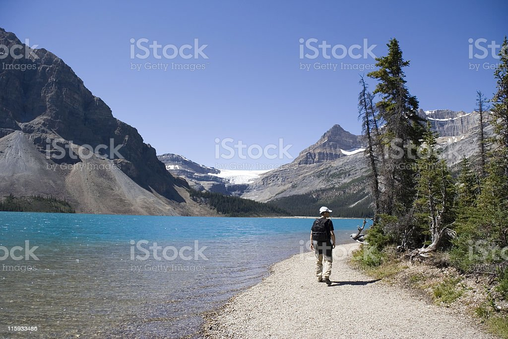 hiker on bow lake stock photo