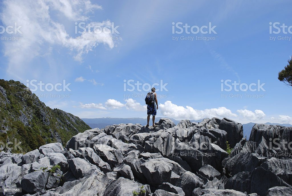 Hiker on Karst Rock, Takaka Hill, New Zealand stock photo