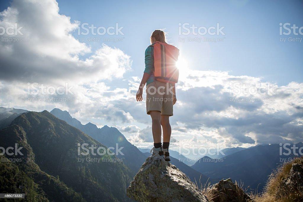 Hiker on mountain top enjoying the view stock photo