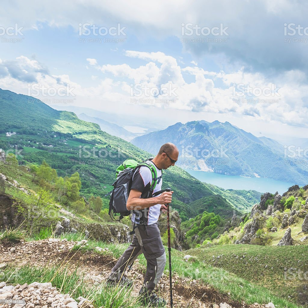 Hiker on mountain trail royalty-free stock photo