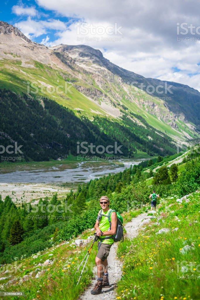 Hiker on mountain trail stock photo