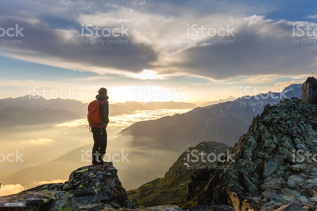Hiker on mountains enjoy sunrise stock photo