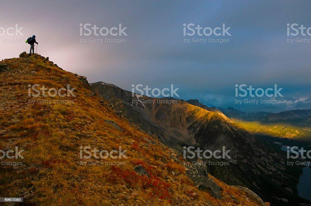 Hiker on summit royalty-free stock photo