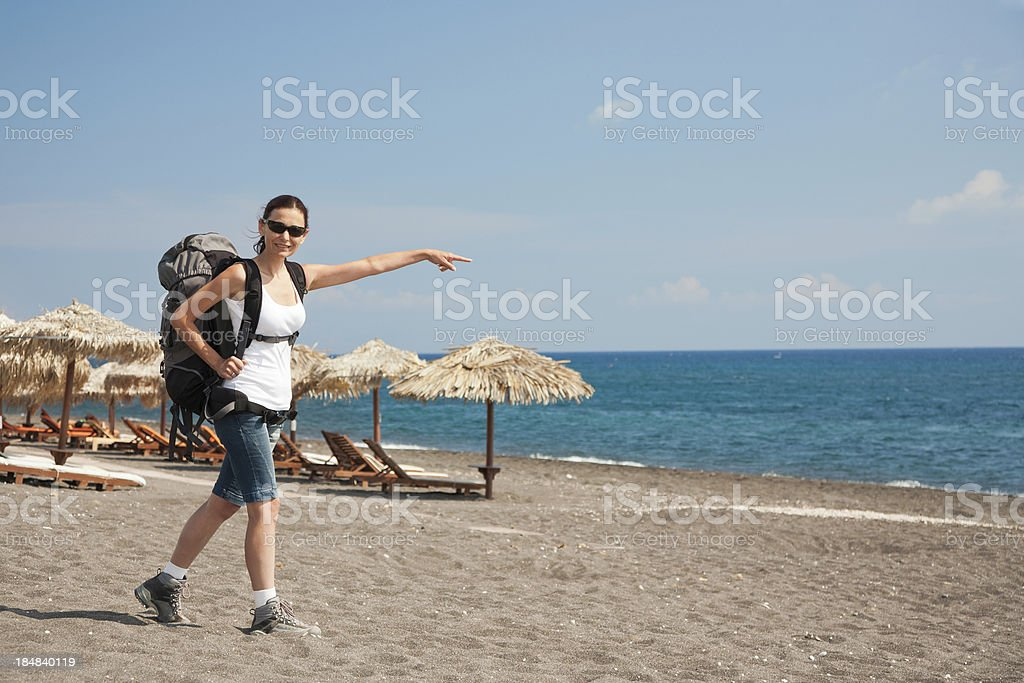 Hiker on the beach stock photo