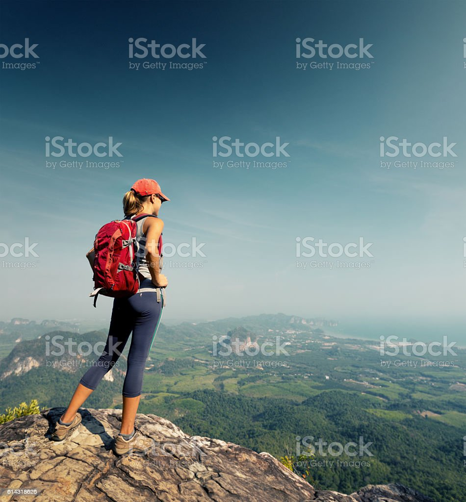 Hiker on the cliff stock photo