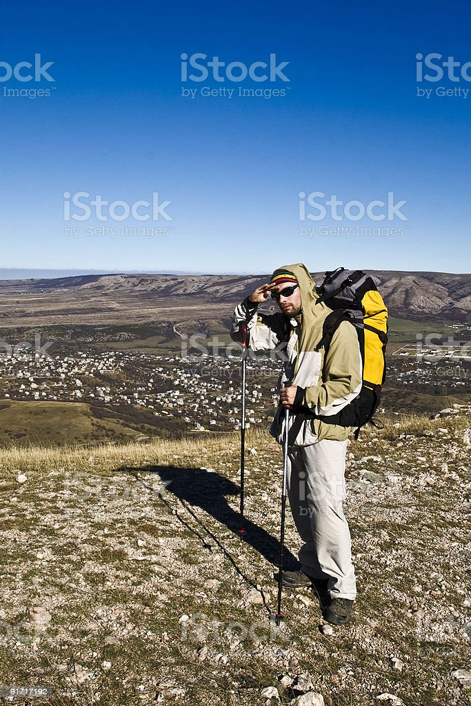 Hiker on the summit looking ahead royalty-free stock photo
