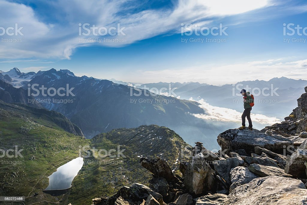 Hiker on top looks mountain panorama stock photo