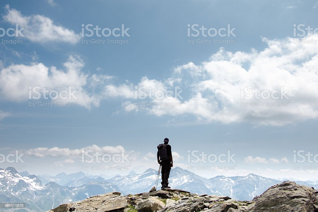Hiker on top of mountain stock photo