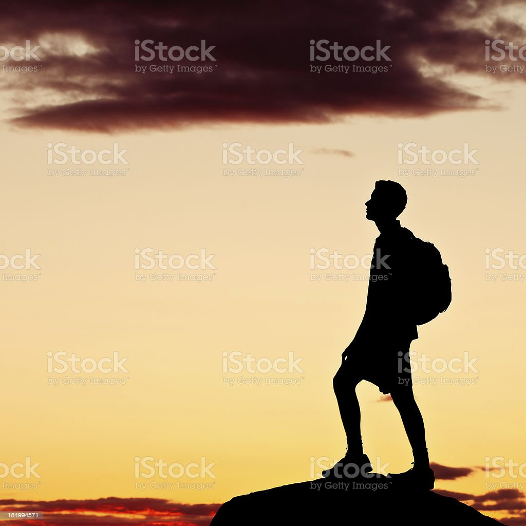 Hiker on top of the mountain after sunset - X royalty-free stock photo