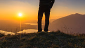 Hiker on top of the mountain during sunset