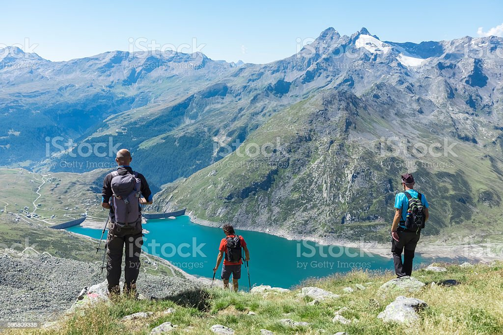 Hiker on top of the mountain range stock photo