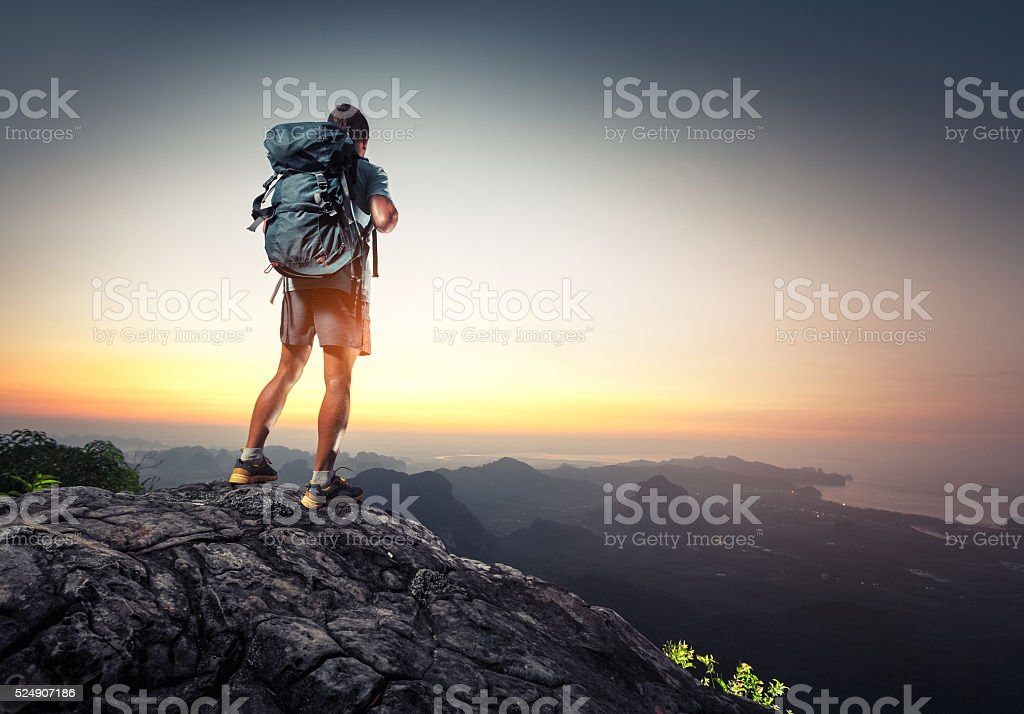 Hiker on top stock photo