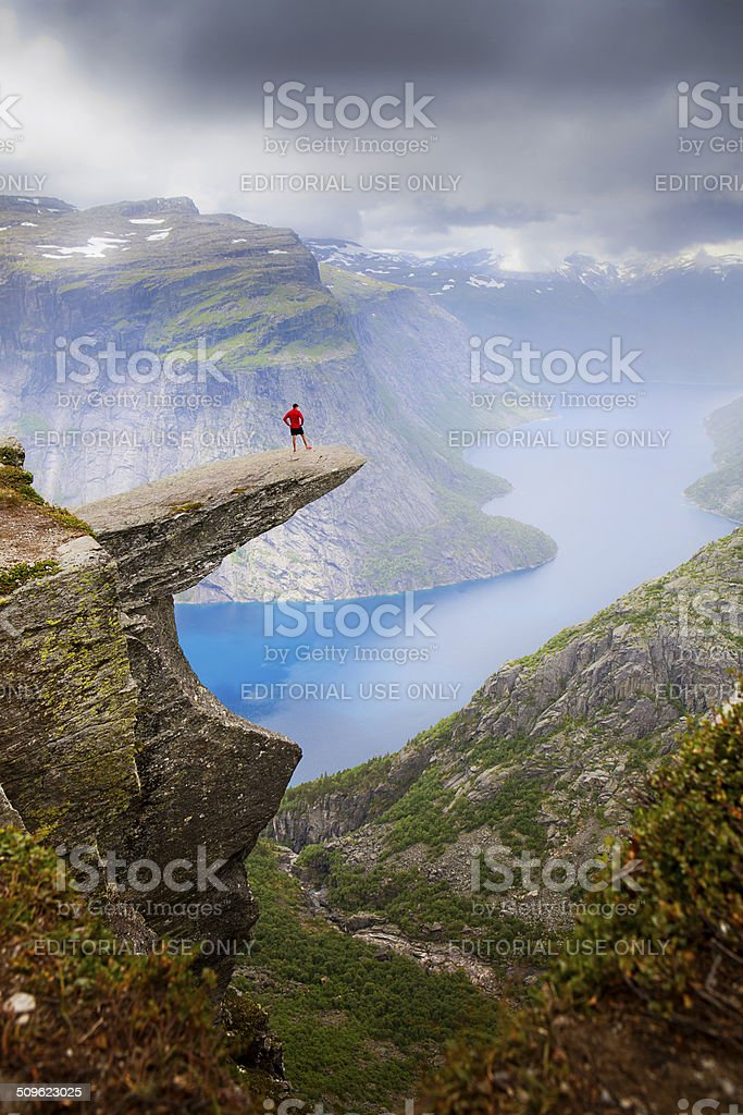 Hiker on Trolltunga stock photo