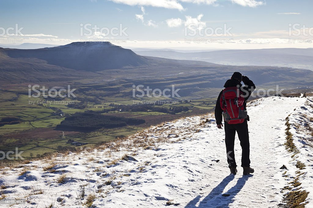 Hiker on Whernside in the snow royalty-free stock photo