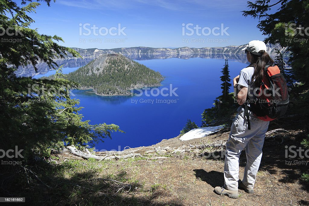HIker Overlooking Crater Lake stock photo