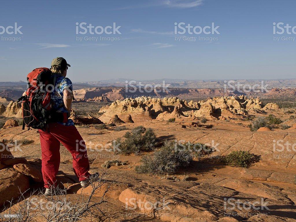 Hiker pausing for a northern Arizona panoramic view stock photo
