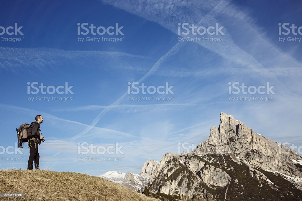 Hiker photographer on a mountain top stock photo