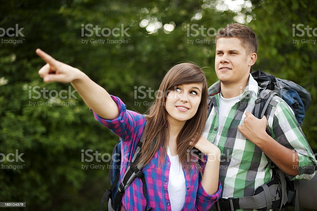 Hiker pointing at something in forest royalty-free stock photo