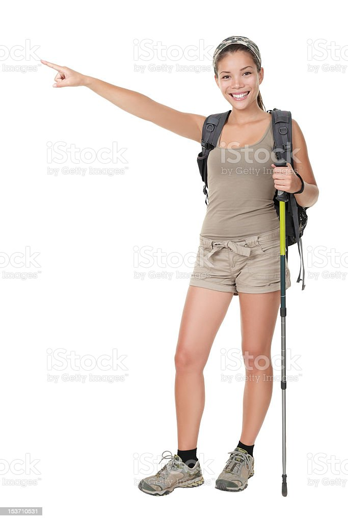 Hiker pointing to the side isolated royalty-free stock photo