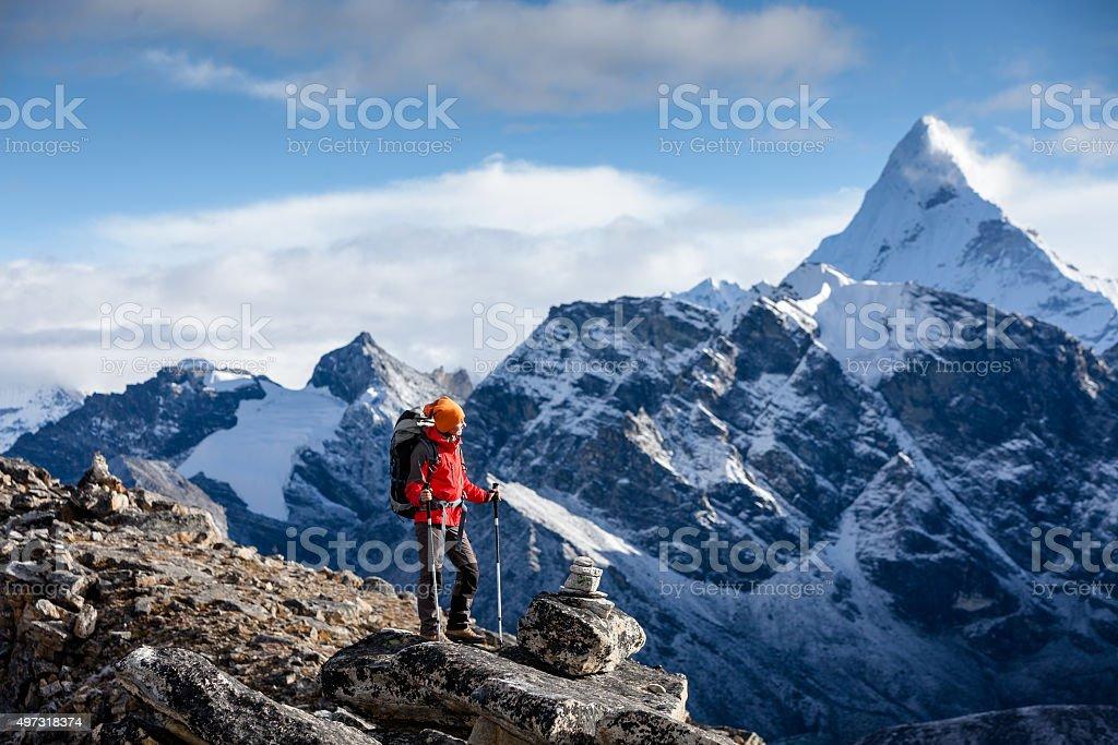 Hiker posing at camera on the trek in Himalayas, Nepal stock photo