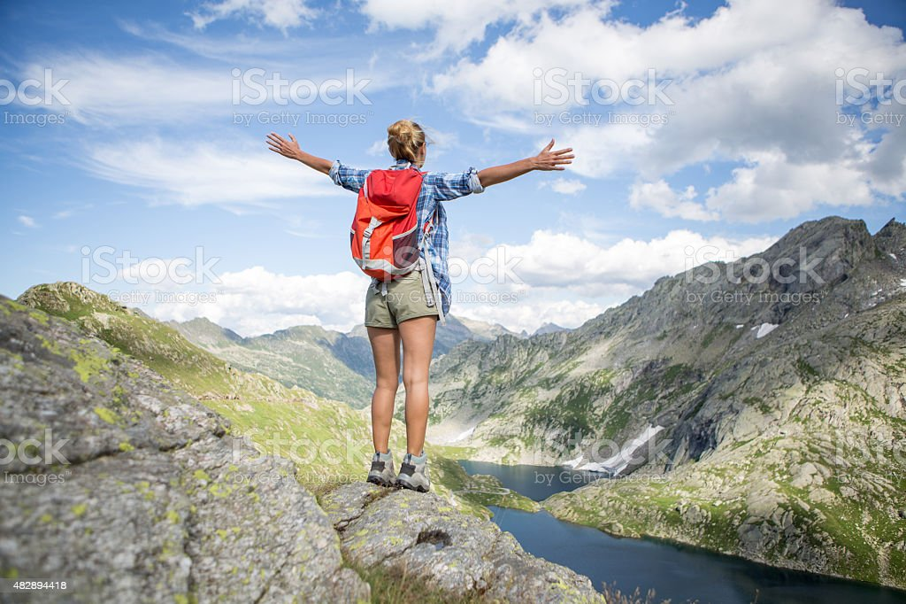 Hiker reaches mountain top-Success stock photo