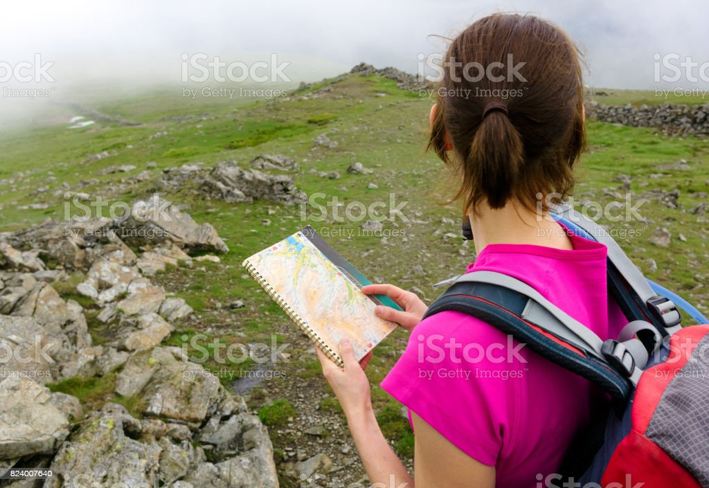 A hiker reading a map stock photo