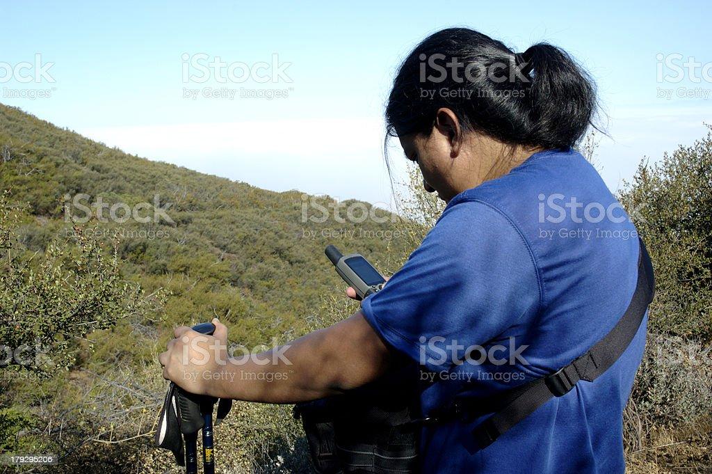 Hiker reading GPS stock photo