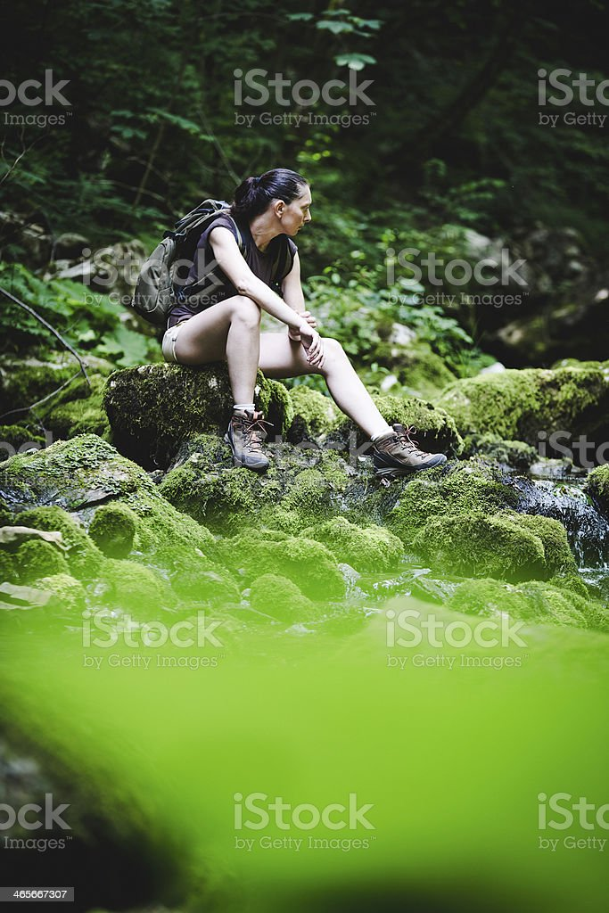 hiker relaxing in a wood royalty-free stock photo