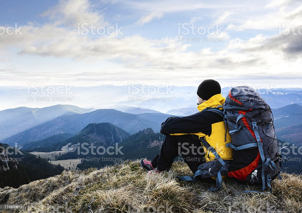 hiker resting and admiring the view stock photo