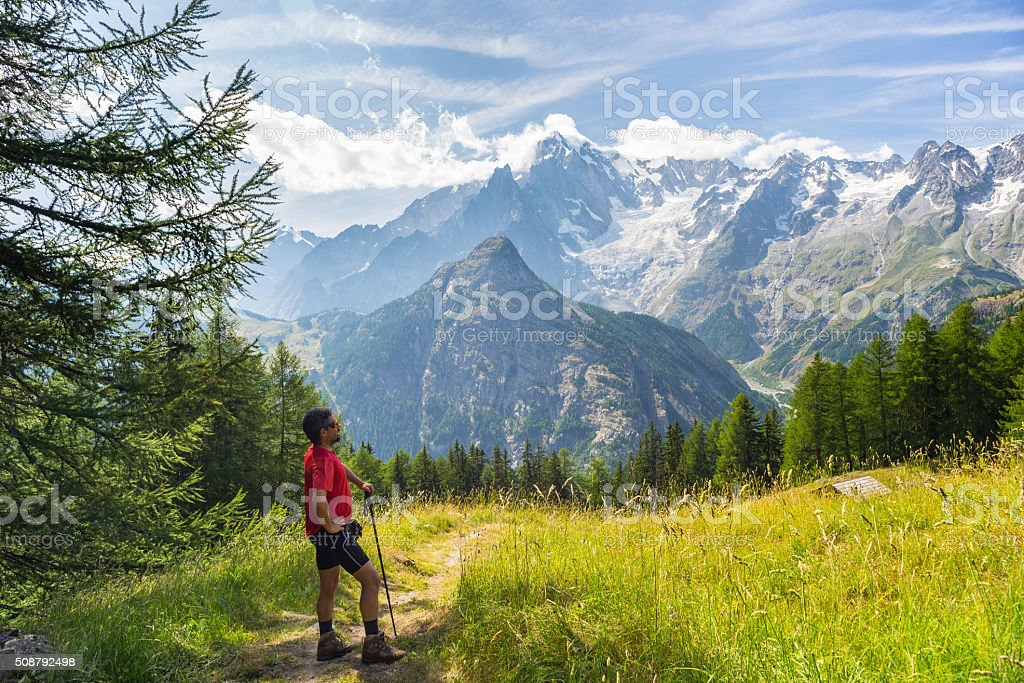 Hiker resting in front of majestic Monte Bianco (Mont Blanc) stock photo