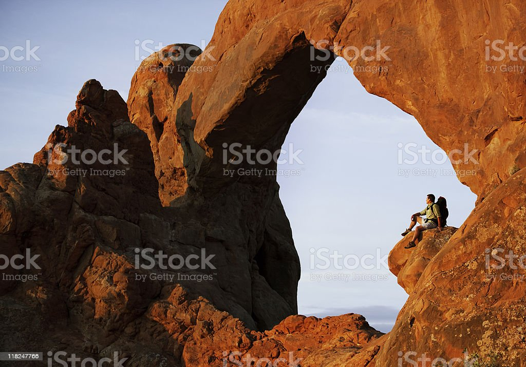 Hiker Resting On Ledge In Arches National Park, Utah royalty-free stock photo