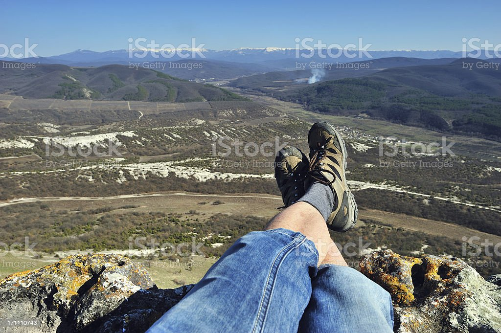 Hiker resting on mountain top royalty-free stock photo