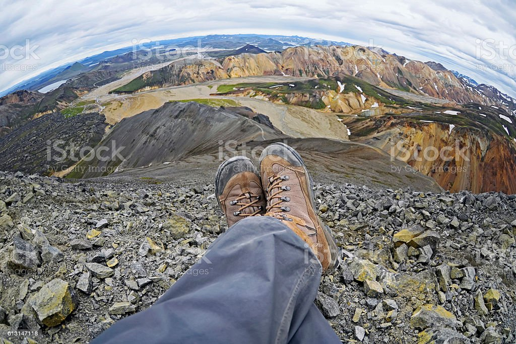 Hiker resting over the Landmannalaugar are rock formations stock photo