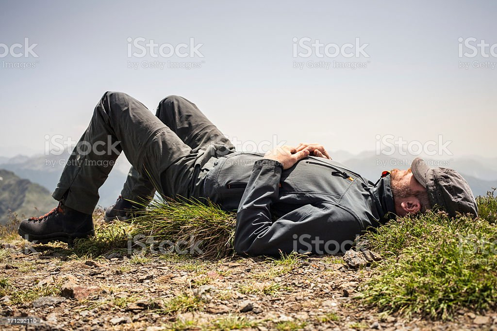 Hiker Rests Top of the Mountain royalty-free stock photo