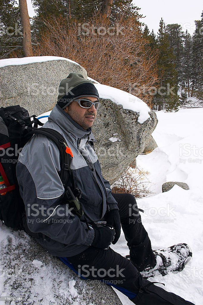 Hiker sitting on a rock royalty-free stock photo