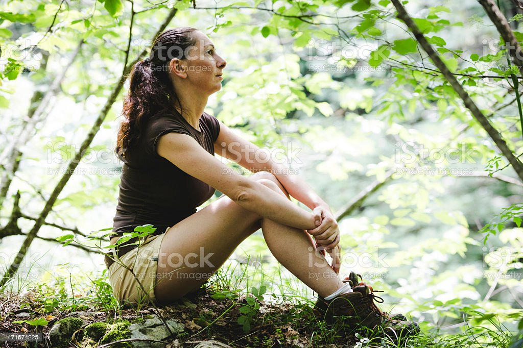 hiker sitting outdoor royalty-free stock photo