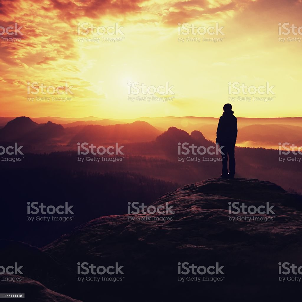 Hiker stand on peak in rock empires park above valley stock photo
