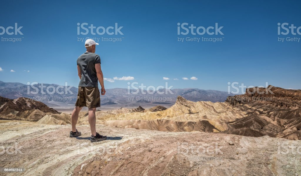 Hiker standing at Zabriskie point  in Death Valley National Park stock photo