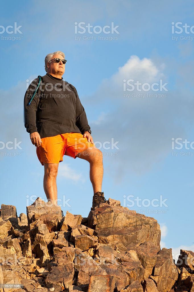 Hiker Standing On A Windy Summit royalty-free stock photo